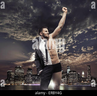 Successful businessman over the town background - Stock Photo