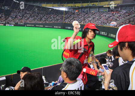 Beer vendors at the Sapporo Dome in Sapporo, Hokkaido during a game of the Nippon Ham Fighters baseball team - Stock Photo