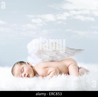 Portrait of a little baby as an innocent angel - Stock Photo