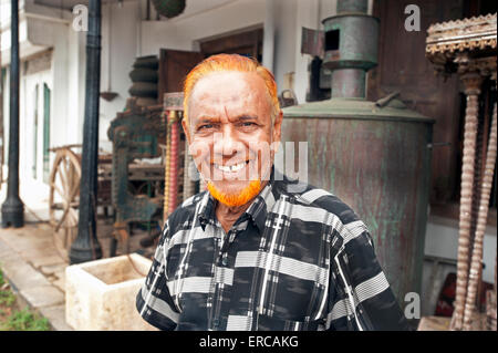 Portrait of a Muslim man with orange dyed hair and beard in the Galle Fort Sri Lanka - Stock Photo