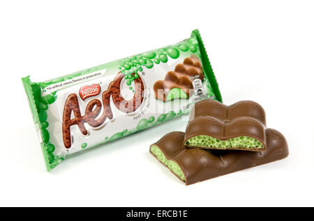 Peppermint aero chocolate bar on white background with open cut up bar by the side - Stock Photo