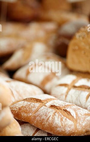 Market stall food displayed artisan breads - Stock Photo