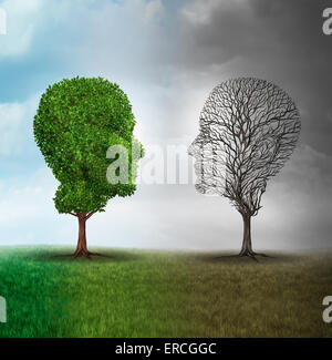 Human mood and emotion disorder concept as a tree shaped as two human faces with one half full of leaves and the - Stock Photo