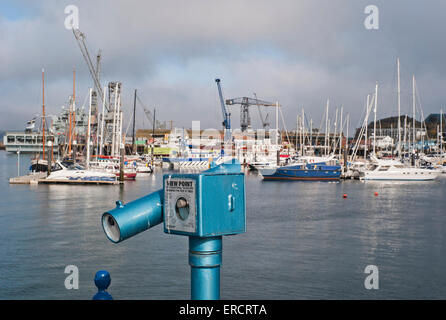 A public coin-operated telescope overlooking the the Packet Quay in  falmouth harbour Cornwall - Stock Photo