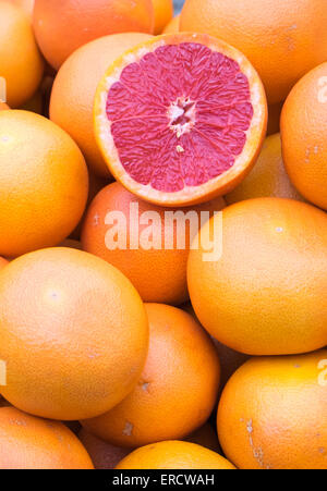 Ripe blood oranges for sale at a market - Stock Photo