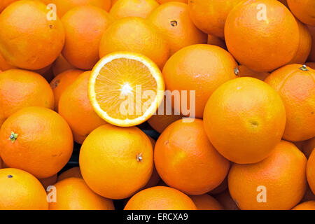 Ripe oranges for sale on a market - Stock Photo