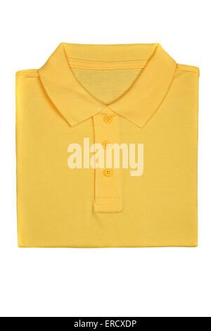 Neatly folded yellow polo shirt isolated on white background - Stock Photo