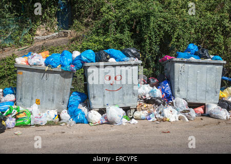 Overflowing rubbish bins waiting to be emptied, Outer Mani, Messenia, Peloponnese, Greece. - Stock Photo
