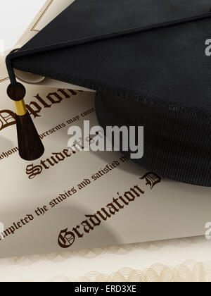 Graduation concept with diploma and mortarboard. - Stock Photo