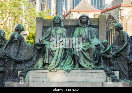 Statue of the Van Eyck brothers behind the St. Bavo's Cathedral (Sint Baafskathedraal), Ghent, Belgium - Stock Photo