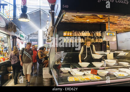 Ready-cooked meals stall at La Boqueria market, Barcelona, Spain - Stock Photo