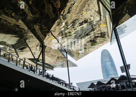 AGBAR tower and mirrored ceiling of Els Encants open-air flea market, Barcelona, Spain - Stock Photo