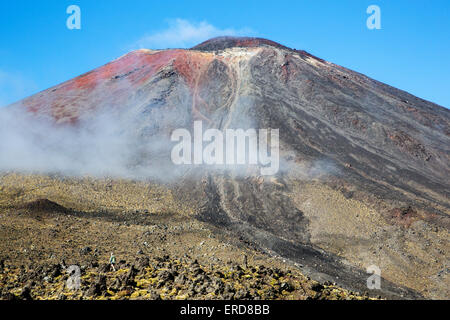 Brooding cone of active volcano Mount Ngauruhoe from the Tongariro Alpine Crossing in New Zealand's North Island - Stock Photo