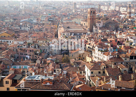 Aerial view of UNESCO World Heritage Site Venice cityscape with roofs of houses from San Marco bell tower, Italy - Stock Photo