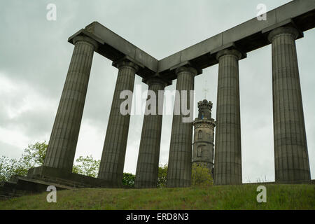 Nelson Monument seen through the columns of the unfinished National Monument of Scotland on Calton Hill - Edinburgh, - Stock Photo