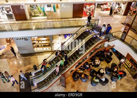 Mumbai India Asian Lower Parel High Street Phoenix mall inside interior Palladium shopping escalators Diesel - Stock Photo