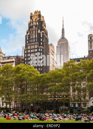 Yoga on the Great Lawn, Bryant Park, American Radiator Building (American Standard Building), Empire State Building, - Stock Photo