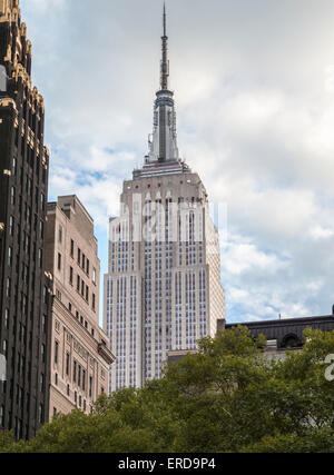 The iconic Empire State Building, viewed from Bryant Park, midtown Manhattan, New York, USA - Stock Photo