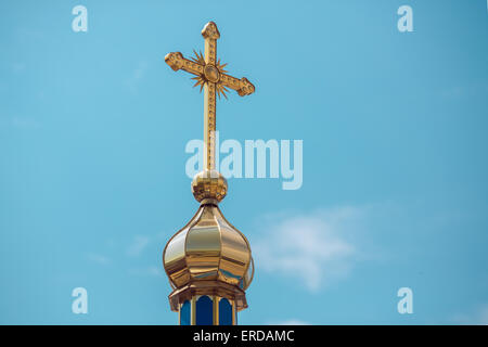 Cross on the top of church. - Stock Photo