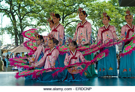 Korean Dancers:Asian female dance group in traditional costume with large fans dancing on stage of music show at - Stock Photo