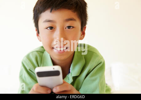 Young boy using smartphone - Stock Photo