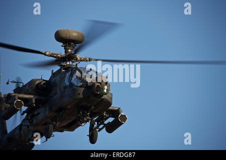 AH-64D Apache Longbow lifts off on a mission in support of exercise Angel Thunder 2013. - Stock Photo