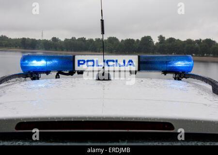 Police car signal siren light, outdoors in the rain - Stock Photo