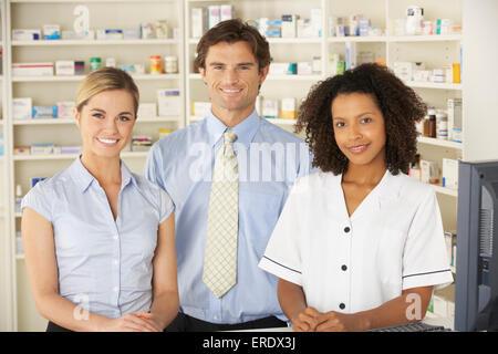 Nurse working on computer in pharmacy - Stock Photo