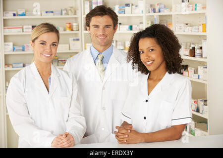 Nurse and pharmacists working in pharmacy - Stock Photo