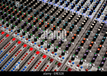 Close-up of knobs on mixing desk - Stock Photo