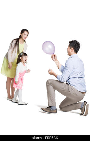 Happy young family with balloon