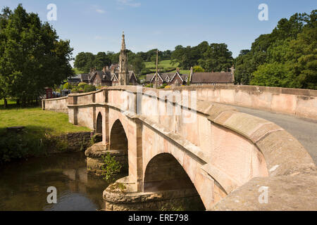 UK, England, Staffordshire, Ilam, bridge over River Manifold and Mary Watts-Russell Memorial Cross - Stock Photo