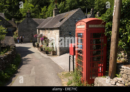 UK, England, Staffordshire, Dovedale, Milldale  old red village K6 phone box - Stock Photo