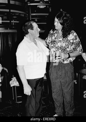 Jim Marshall, OBE (left, b. 1923), founder of Marshall Amplification, is pictured talking with Ian Gillan (b. 1945), - Stock Photo
