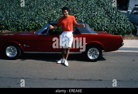 Portrait of Mario López in front of a red vintage car, Los Angeles, USA. Mario López, American film, TV and theatre - Stock Photo