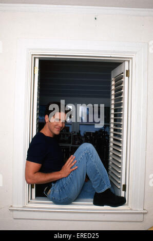 Michael Damian, portrait in a window in Los Angeles, USA. American actor, singer and producer, b April 26, 1962 - Stock Photo