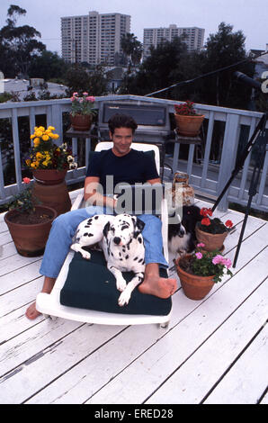 Michael Damian, portrait with dalmatian in Los Angeles, USA. American actor, singer and producer, b April 26, 1962 - Stock Photo