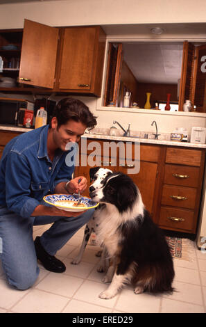 Michael Damian, portrait with his dogs, Los Angeles, USA. American actor, singer and producer, b April 26, 1962 - Stock Photo