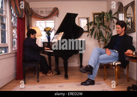 Michael Damian, portrait with his mother playing the piano in Los Angeles, USA. American actor, singer and producer, - Stock Photo