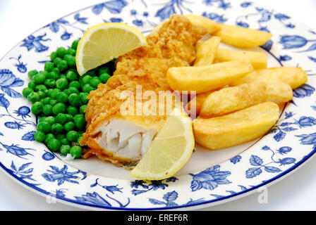 COD FISH & CHIPS WITH PEAS AND SLICE OF LEMON - Stock Photo