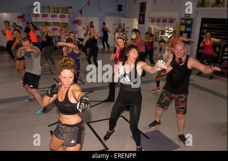 People taking part in a Insanity Combat-Athon for a cancer charity, Alton, Hampshire, UK. - Stock Photo
