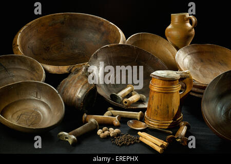 A collection of domestic artefacts recovered from the Mary Rose.  A wooden Tigg, bowls, a jug, dagger handles and - Stock Photo