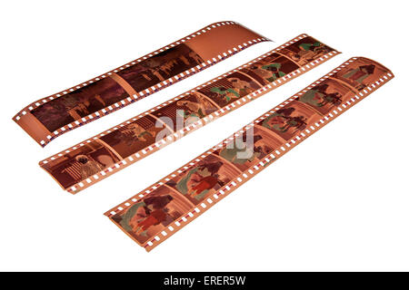 Strips of  old 35 mm colour negative on white - Stock Photo