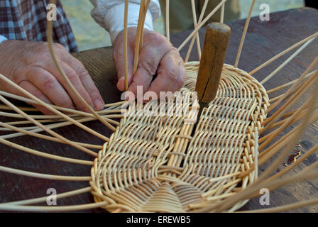 Close-up of basket weaver's hands - demonstrations of traditional skills in the village of Chusclan, Southern France. - Stock Photo