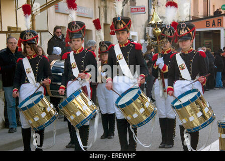 Four drummers of the Musique du Tambour d'Arcole in Napoleonic light infantry uniform,   performing in the village - Stock Photo