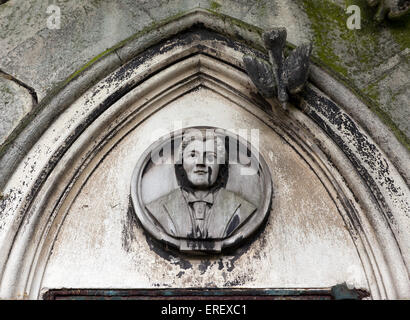 Close-up view of a memorial plaque above the entrance to a Tomb, in Brompton Cemetery. - Stock Photo