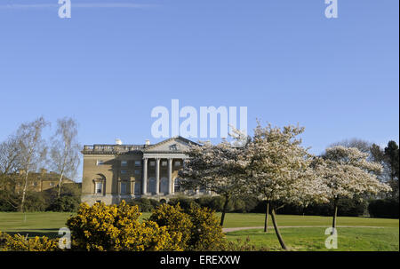 View over Spring blossom and Gorse bush to Thorndon Hall, Thorndon Park Golf Club Brentwood Essex England - Stock Photo