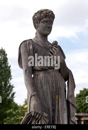 Close-up of a stone memorial Statue in Brompton Cemetery, The Royal Borough of Kensington and Chelsea, London, - Stock Photo