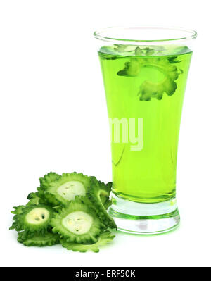 Herbal juice of green momodica in glass over white background