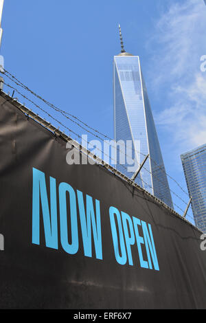 Fence near Ground Zero with World Trade Center Tower One in the background. - Stock Photo
